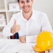 Confident young architect in his office — Stock Photo #18927537