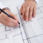 Architect working on blueprints — Stock Photo