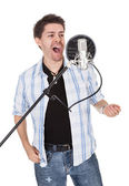 Singer and microphone — Stock Photo
