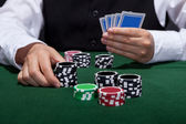 Poker player about to place a bet — Stock Photo