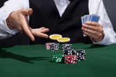 Poker player increasing his stakes — Stock Photo