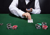 Croupier dealing cards — Stock Photo