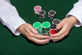 Croupier collecting in the bets — Stock Photo