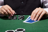 Hand of croupier — Stockfoto