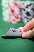 Poker player checking a pair of aces — Stock Photo