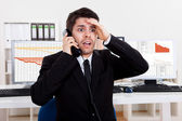Worried stock broker on the phone — Foto Stock