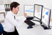 Stock broker trading in a bull market — Stock Photo