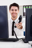 Smiling stock broker with telephone — Stock Photo