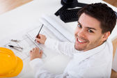 Architect working on blueprints — Stock Photo