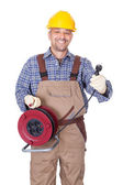 Happy Electrician Holding Wire Plug — Stock Photo