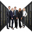 Businessteam standing on front of server racks — Stock Photo
