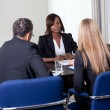 Group of managers interviewing female candidate — Stock Photo #19637965