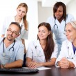 Friendly group of doctors at the hospital - Stock Photo