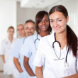Young female doctor with group of colleagues — Stock Photo