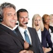 Businesspeople working in a call center — Stock Photo
