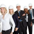 Female civil engineer standing with her team — Stock Photo
