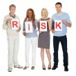 Stock Photo: Group of holding sign board illustrating risk