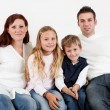 Happy family with their children — Stock Photo #19638193