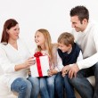 Happy mom receiving a gift from her kids — Stock Photo