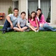 Caucasian family portrait sitting - Stock Photo