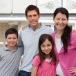 Beautiful young family standng together — Stock Photo