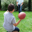 Foto Stock: Father and son playing american football