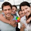 Portrait of happy family enjoying outdoors — Stock Photo