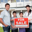 Portrait of family selling their house — Stock Photo