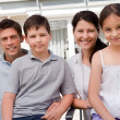 Portrait of smiling young family together - Stock Photo