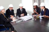 Group of engineers working together — Stock Photo