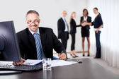 Successful businessman doing some paperwork — Stock Photo