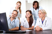 Friendly group of doctors at the hospital — Stock Photo