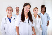 Portrait of a young doctor smiling with colleagues — Stock Photo