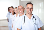 Portrait of a mature male doctor standing — Stock Photo