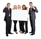Business with thumbs up holding blank board — Stock Photo