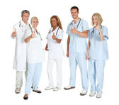Group of happy doctors with thumbs up — Stock Photo