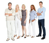 Business group standing confidently on white — Stock Photo
