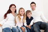 Happy family with their children — Stockfoto