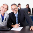 Doctor discussing with patient at his clinic — Stock Photo
