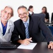 Doctor discussing with patient at his clinic — Stock Photo #19925887