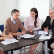 Creative workgroup reviewing new business plans in a meeting — Stock Photo