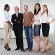 Diverse business group standing together - Stock Photo