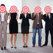 Group of business holding a target - Stock Photo