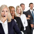 Stock Photo: Successful business team with headsets