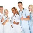Friendly group of doctors with thumbs up on white — Stock Photo