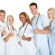 Stock Photo: Friendly group of doctors with thumbs up on white
