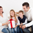 Happy mom receiving a gift from her kids — Foto de Stock