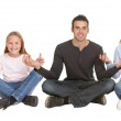 Couple sitting in yoga position — Stock Photo #19926515