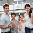 Excited family celebrating success - Stock Photo