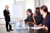 Successful business executive heading conference — Stock Photo